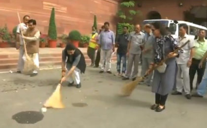 Delhi: BJP MPs including Minister of State (Finance) Anurag Thakur and Hema Malini take part in 'Swachh Bharat Abhiyan' in Parliament premises.